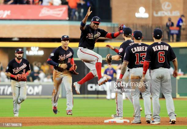 Victor Robles of the Washington Nationals celebrates with his teammates after their 5-4 win over the Houston Astros in Game One of the 2019 World...