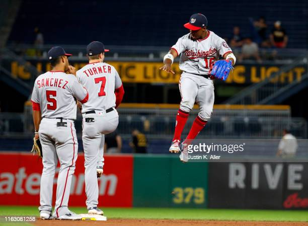 Victor Robles of the Washington Nationals celebrates with teammates Trea Turner and Adrian Sanchez after defeating the Pittsburgh Pirates at PNC Park...