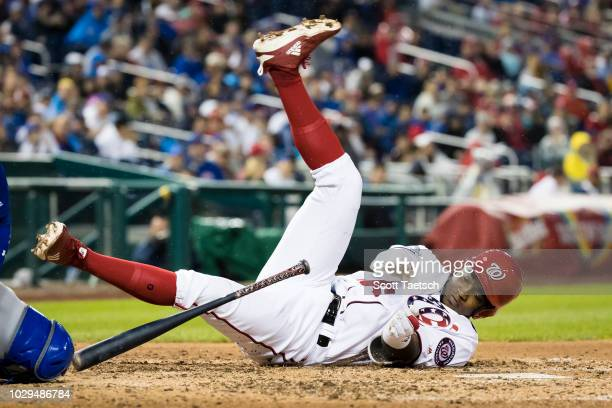 Victor Robles of the Washington Nationals is hit by a pitch against the Chicago Cubs during the seventh inning of game one of a doubleheader at...