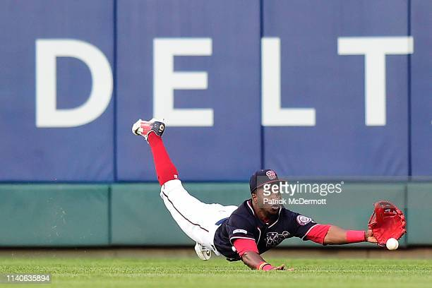 Victor Robles of the Washington Nationals is unable to catch a ball that went for an RBI double off the bat of Marcell Ozuna of the St. Louis...