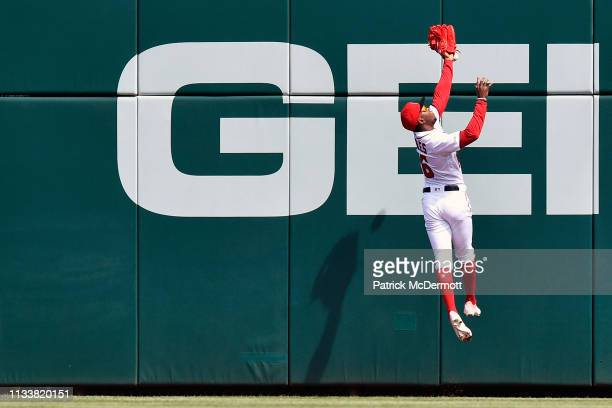 Victor Robles of the Washington Nationals is unable to catch an RBI triple by Jeff McNeil of the New York Mets in the first inning at Nationals Park...