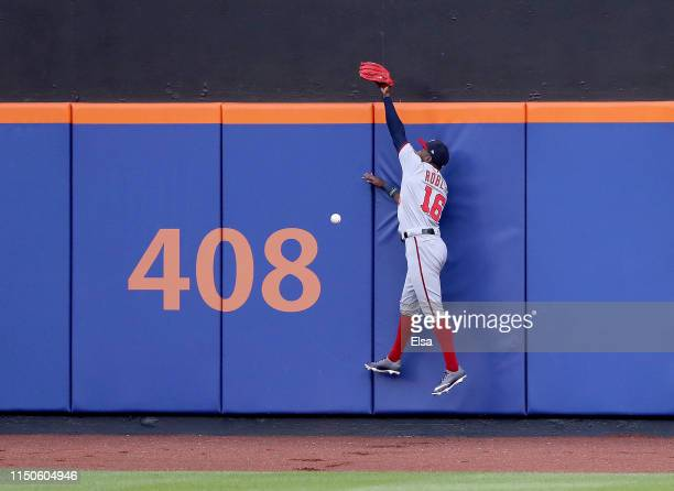 Victor Robles of the Washington Nationals is unable to field a hit by Amed Rosario of the New York Mets in the first inning at Citi Field on May 20...
