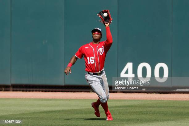 Victor Robles of the Washington Nationals makes a catch against the Miami Marlins during a Grapefruit League spring training game at Roger Dean...