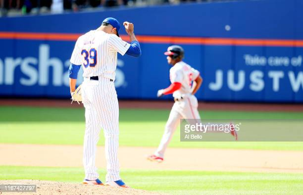 Victor Robles of the Washington Nationals rounds the bases after hitting a ninth inning two run home run against Edwin Diaz of the New York Mets...