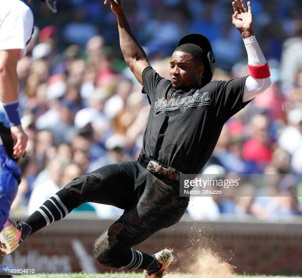 Victor Robles of the Washington Nationals scores during the third inning of a game against the Chicago Cubs at Wrigley Field on August 23 2019 in...