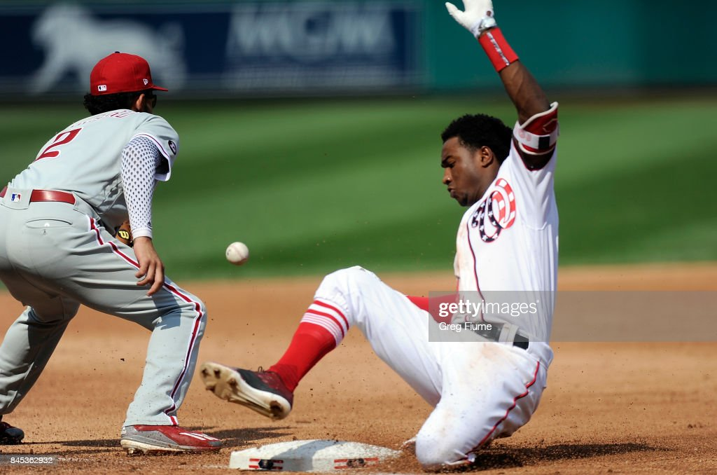 Victor Robles #14 of the Washington Nationals slides into third base in the sixth inning against the Philadelphia Phillies at Nationals Park on September 10, 2017 in Washington, DC. Robles got his first carrer hit with a double but was out on the play over-sliding third base.