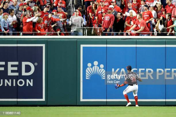 Victor Robles of the Washington Nationals watches a tworun home run hit by Yordan Alvarez of the Houston Astros leave the park during the second...