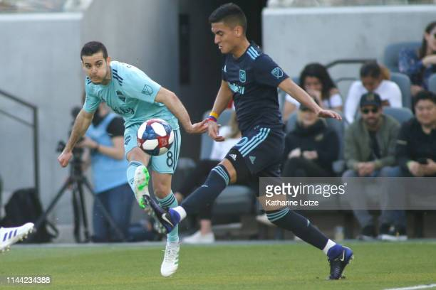 Victor Rodriguez of Seattle Sounders and Eduard Atuesta of Los Angeles FC fight for control of the ball during the first half of a game at Banc of...