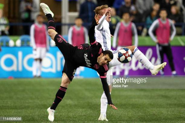 Victor Rodriguez of Seattle Sounders and Jackson Yueill of San Jose Earthquakes collide in the second half during their game at CenturyLink Field on...