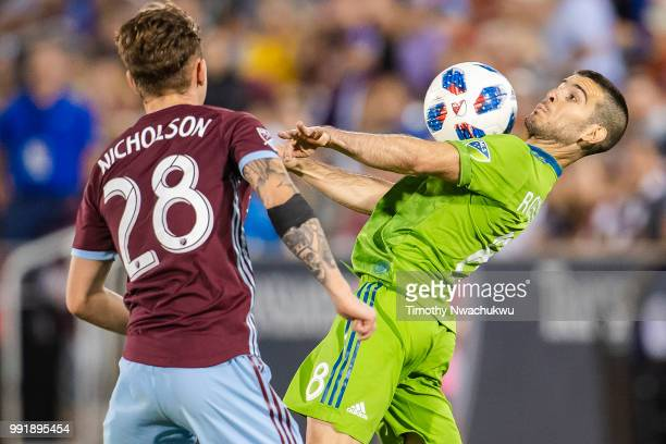 Victor Rodriguez of Seattle Sounders controls the ball against Sam Nicholson of Colorado Rapids at Dick's Sporting Goods Park on July 4 2018 in...