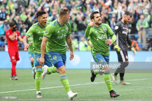Victor Rodriguez of the Seattle Sounders celebrates with teammates after scoring a goal in the second half to give the Seattle Sounders a 20 lead...
