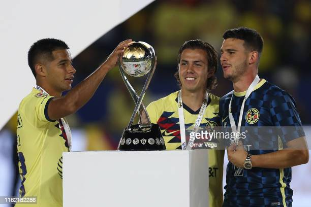 Victor Rodriguez touches the trophy after winning the match between Club America and Tigres UANL as part of the Campeon de Campeones Cup at Dignity...