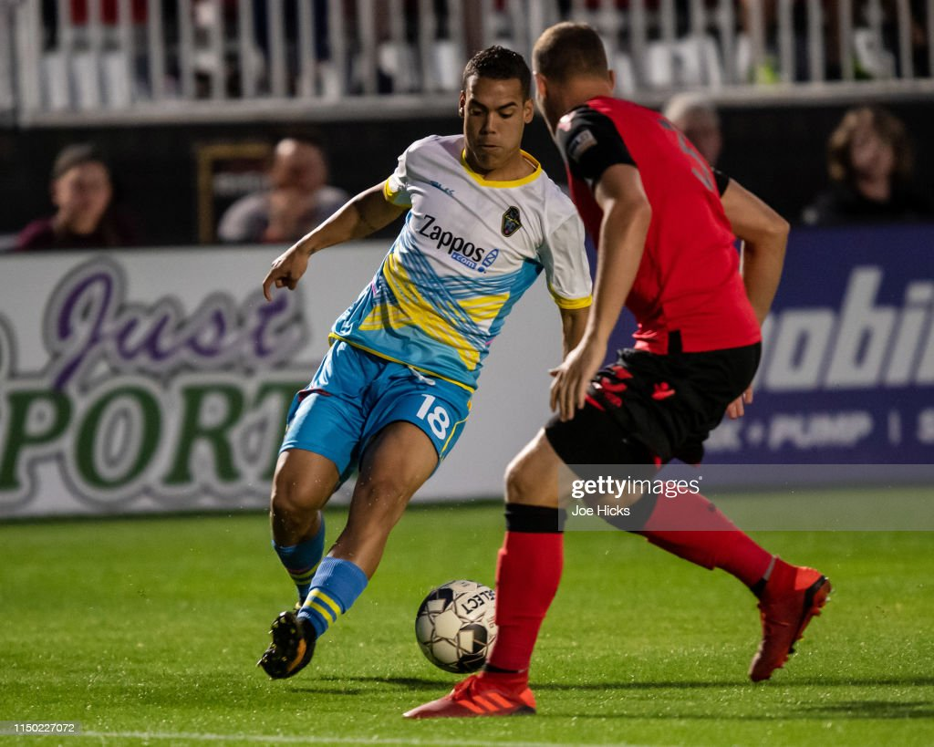 Victor Rojas of Las Vegas Lights FC looks to move the ball
