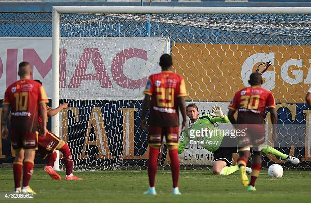Victor Rossel of UTC scores the first goal of his team from the penalty spot during a match between Sporting Cristal and UTC as part of 4th round of...