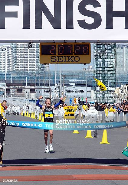 Victor Rothlin of Switzerland celebrates as he approaches the finish line during the 2008 Tokyo Marathon at Tokyo Big Sight on February 17 2008 in...