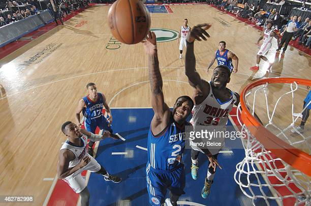 Victor Rudd of the Delaware 87ers battles for the ball with Willie Reed of the Grand Rapids Drive during the NBA D-League game on January 31, 2015 at...