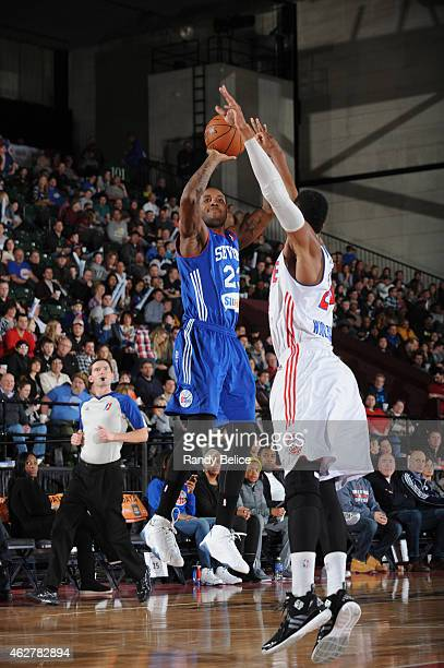 Victor Rudd of the Delaware 87ers put up a shot over Renaldo Woolridge of the Grand Rapids Drive during the NBA D-League game on January 31, 2015 at...