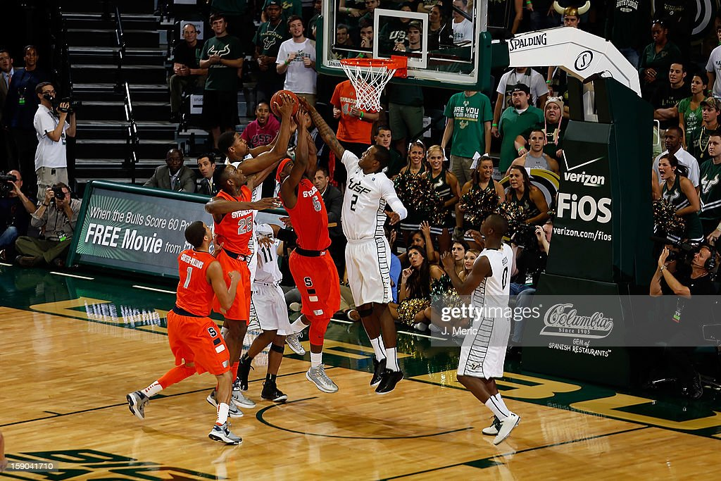 Victor Rudd #2 of the South Florida Bulls blocks the shot of C.J. Fair #5 of the Syracuse Orange during the game at the Sun Dome on January 6, 2013 in Tampa, Florida.