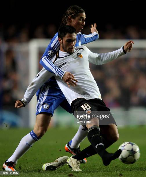 Victor Ruiz of Valencia loses his boot as he is tackled by Fernando Torres of Chelsea during the UEFA Champions League group E match between Chelsea...
