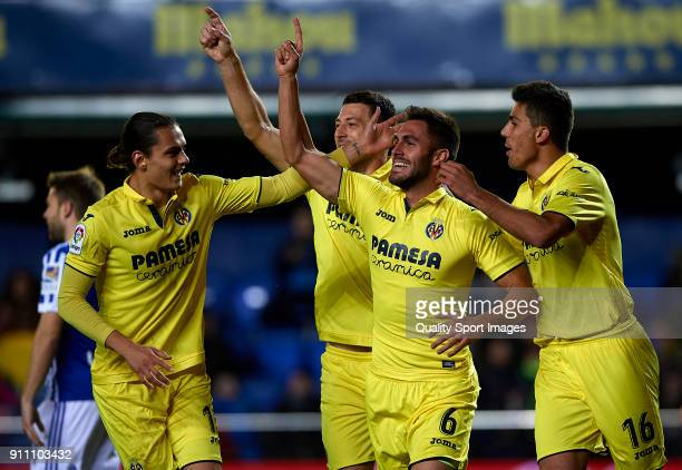 Victor Ruiz of Villarreal celebrates after scoring his sides first goal with his teammates during the La Liga match between Villarreal and Real...