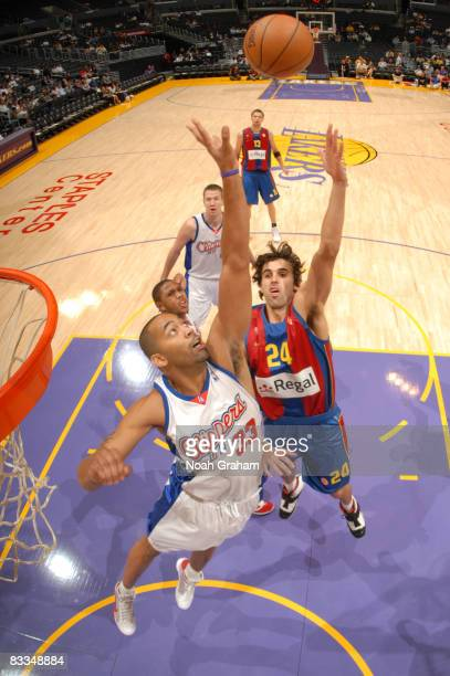 Victor Sada of Regal FC Barcelona has his shot contested by Jelani McCoy of the Los Angeles Clippers at Staples Center on October 19 2008 in Los...