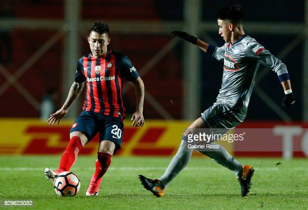 Victor Salazar of San Lorenzo fights for the ball with Fernando Gaibor of Emelec during a second leg match between San Lorenzo and Emelec as part of...