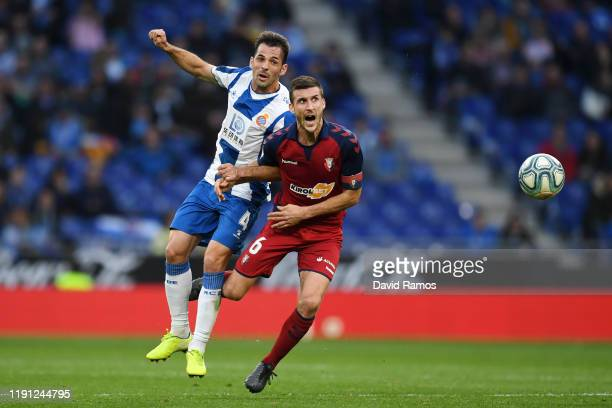 Victor Sanchez of Espanyol and Oier Sanjurjo of Osasuna battle for the ball during the La Liga match between RCD Espanyol and CA Osasuna at RCDE...