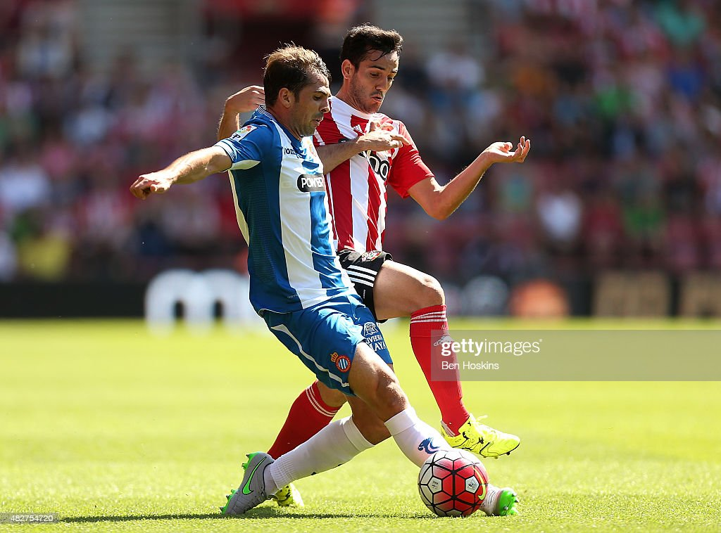 Victor Sanchez of Espanyol holds off pressure from Juanmi of Southampton during the pre season friendly match between Southampton and Espanyol at St Mary's Stadium on August 2, 2015 in Southampton, England.