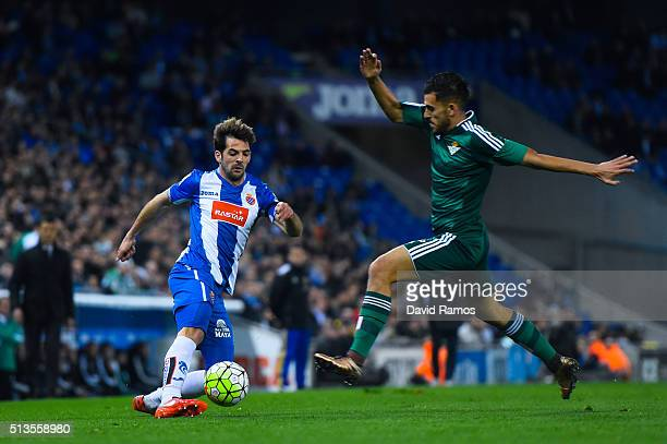 Victor Sanchez of RCD Espanyol competes for the ball with Dani Ceballos of Real Betis Balompie during the La Liga match between Real CD Espanyol and...