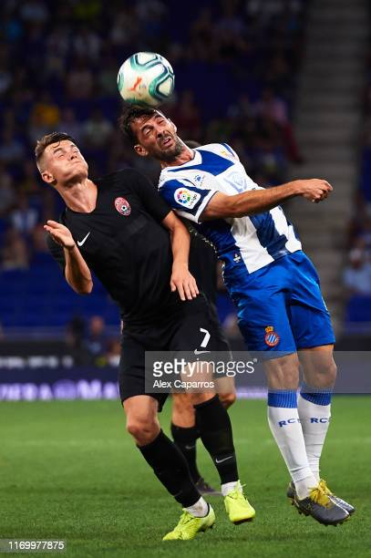Victor Sanchez of RCD Espanyol competes for the ball with Vladyslav Kochergin of Zorya Luhansk during the UEFA Europa League Play Off match between...