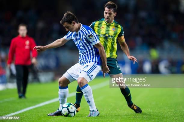 Victor Sanchez of RCD Espanyol duels for the ball with Mikel Oyarzabal of Real Sociedad during the La Liga match between Real Sociedad de Futbol and...