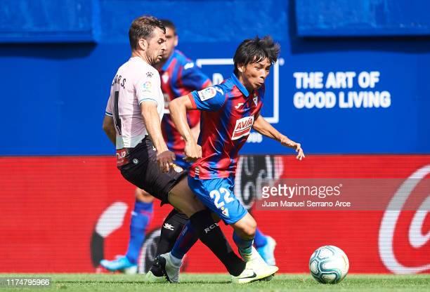 Victor Sanchez of RCD Espanyol duels for the ball with Takashi Inui of SD Eibar during the Liga match between SD Eibar SAD and RCD Espanyol at Ipurua...