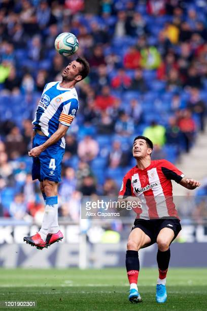 Victor Sanchez of RCD Espanyol heads the ball next to Yuri Berchiche of Athletic Club during the Liga match between RCD Espanyol and Athletic Club at...