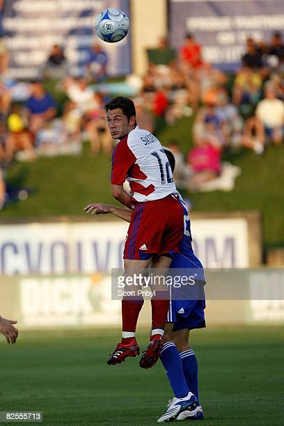 Victor Sikora of FC Dallas wins a head ball against the Kansas City Wizards during the game at Community America Ballpark on August 23, 2008 in...