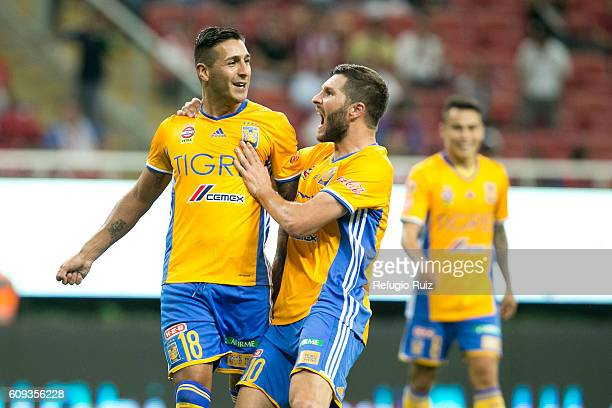Victor Sosa of Tigres celebrates with teammate Andre Gignac after scoring the opening goal during the 10th round match between Chivas and Tigres as...