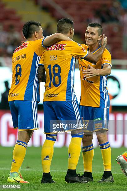 Victor Sosa of Tigres celebrates with teammates after scoring the opening goal during the 10th round match between Chivas and Tigres as part of the...