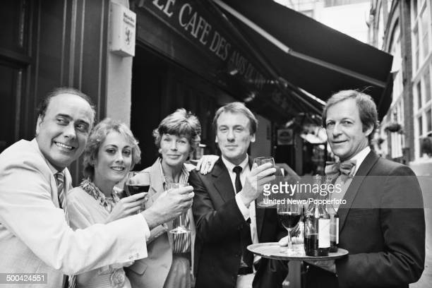 Victor Spinetti Paula Wilcox Dawn Addams Christopher Timothy and Miles Kington pictured together in a London street on 16th July 1984
