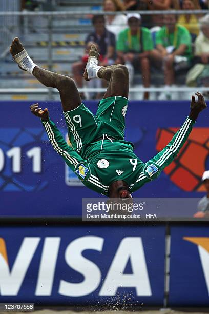 Victor Tale of Nigeria celebrates scoring a goal with a back flip during the FIFA Beach Soccer World Cup Group C match between Venezuela and Nigeria...
