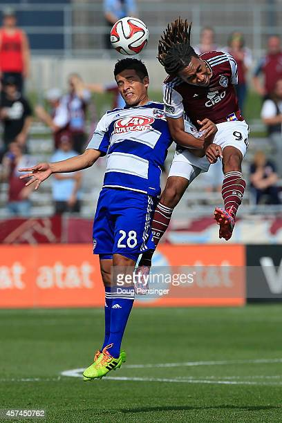 Victor Ulloa of FC Dallas and Marlon Hairston of Colorado Rapids battle for a head ball at Dick's Sporting Goods Park on October 18 2014 in Commerce...