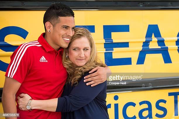 Victor Ulloa of FC Dallas hugs his former teacher Deanna Toler as part of Farmers Insurance's 'Thank America's Teachers' program at Francisco...