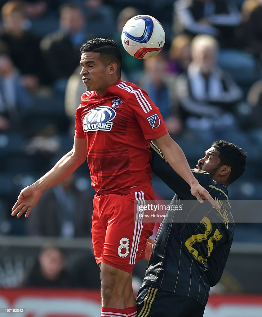 Victor Ulloa #8 of FC Dallas tries to head the ball while getting pushed by Sheanon Williams #25 of Philadelphia Union at PPL Park on March 21, 2015 in Chester, Pennsylvania.