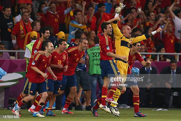 Victor Valdes and Cesc Fabregas of Spain celebrate after victory during the UEFA EURO 2012 final match between Spain and Italy at the Olympic Stadium...