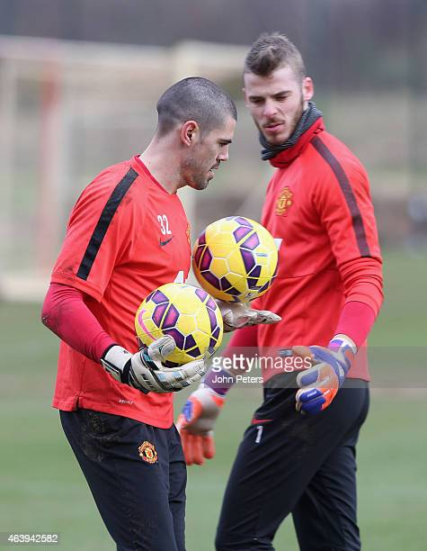 Victor Valdes and David de Gea of Manchester United in action during a first team training session at Aon Training Complex on February 20 2015 in...