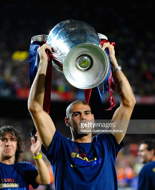 Victor Valdes holds the UEFA Champions League trophy with Alksander Hleb at the Nou Camp stadium the day after Barcelona won the UEFA Champions...