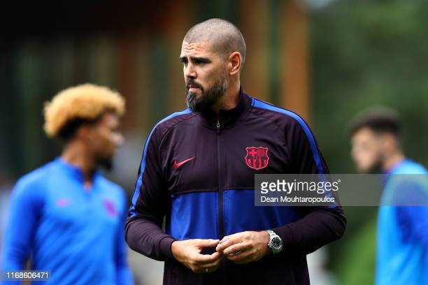Victor Valdes, Manager / Head Coach of U19 FC Barcelona gives his players instructions from the sidelines during The Otten Cup match between PSV...
