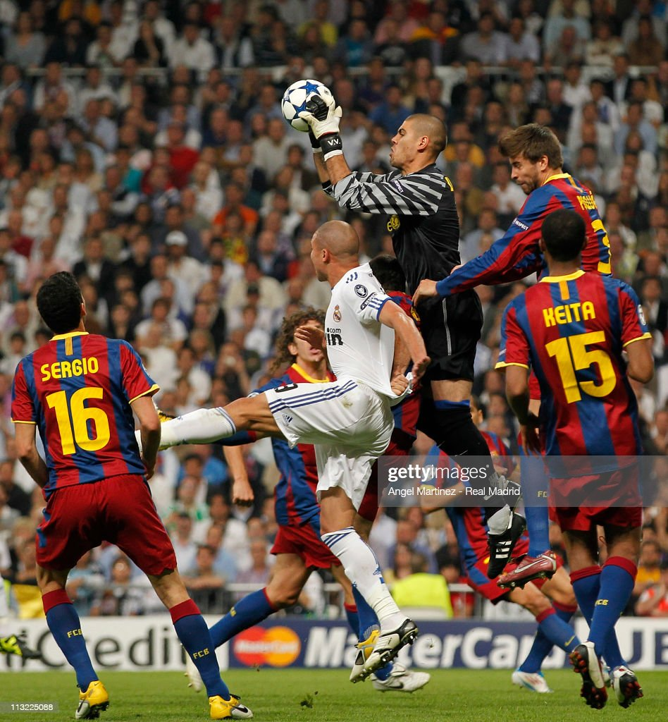 Victor Valdes of Barcelona catches the ball beside Pepe of Real Madrid during the UEFA Champions League Semi Final first leg match between Real Madrid and Barcelona at Estadio Santiago Bernabeu on April 27, 2011 in Madrid, Spain.