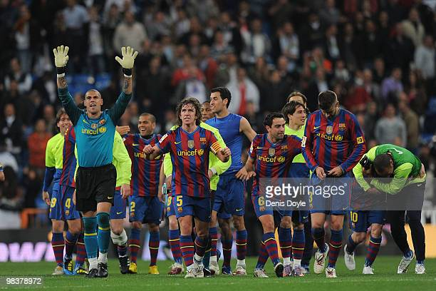 Victor Valdes of Barcelona celebrates with teammates after Barcelona beat Real Madrid 20 in the La Liga match between Real Madrid and Barcelona at...