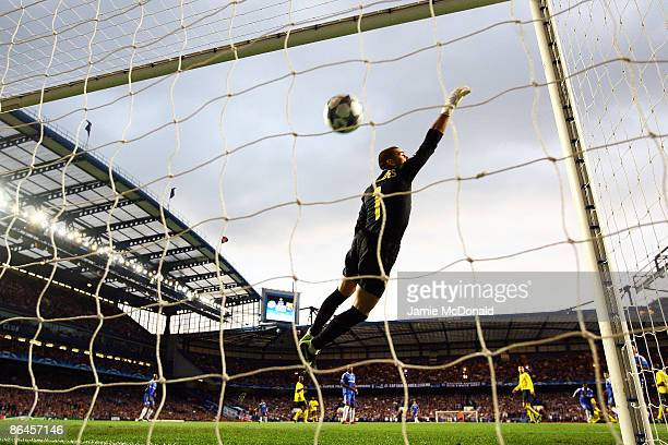 Victor Valdes of Barcelona dives but can not stop the shot from Michael Essien of Chelsea scoring the first goal of the game during the UEFA...