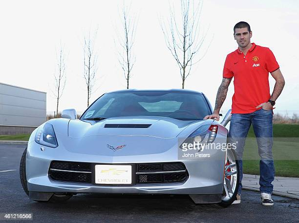 Victor Valdes of Manchester United poses with his Chevrolet after signing for the club at Aon Training Complex on January 8 2015 in Manchester England