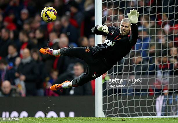 Victor Valdes of Manchester United takes part in the warmup before the Barclays Premier League match between Manchester United and Southampton at Old...